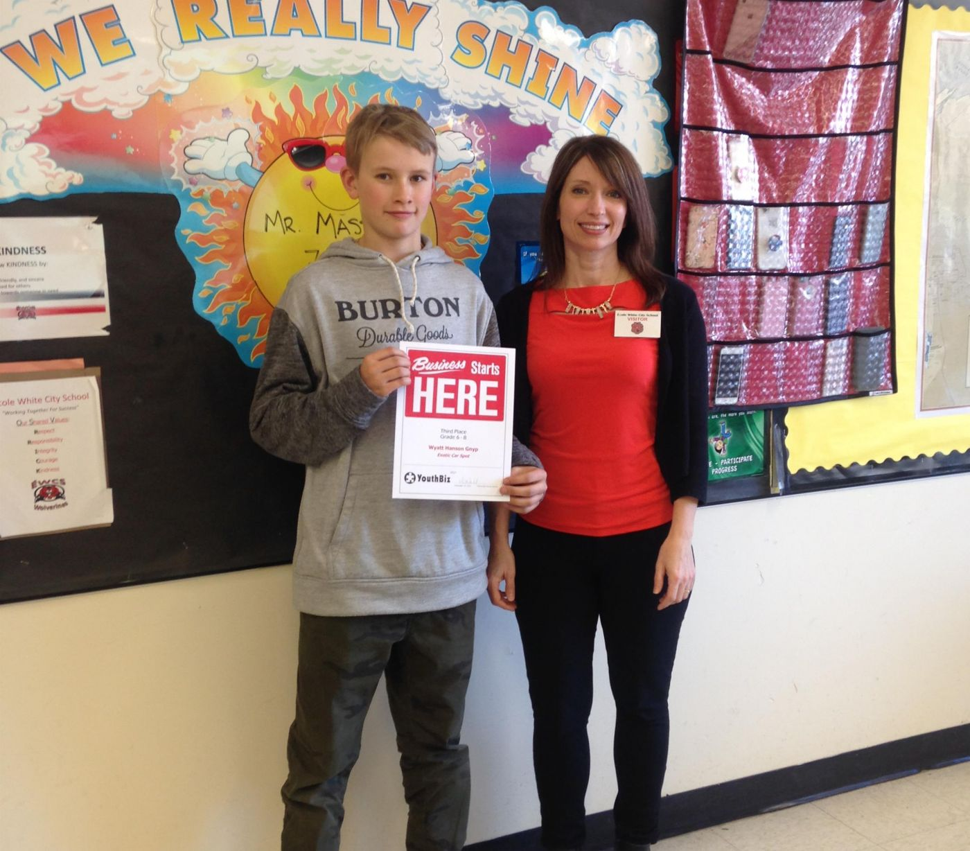 Wyatt Hanson Gnyp from Ecole White City School accepts his 3rd Place award from CF Sunrise's Verna O'Neill